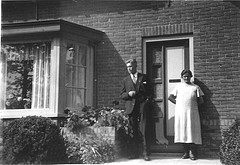 Willemina Berendina van Nijkerken and her son Hendrik Hoitink in front of their home at the Vredenseweg 97, Winterswijk.